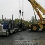 M.D. Transport Flat Bed Transportation Loading Heavy Machinery
